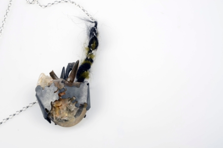 C1-A-925 silver, resin, latex, fossilized sharks teeth and felt